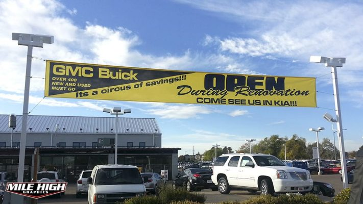 Photo of outdoor mesh banner by Mile High Graphics for GMC-Buick