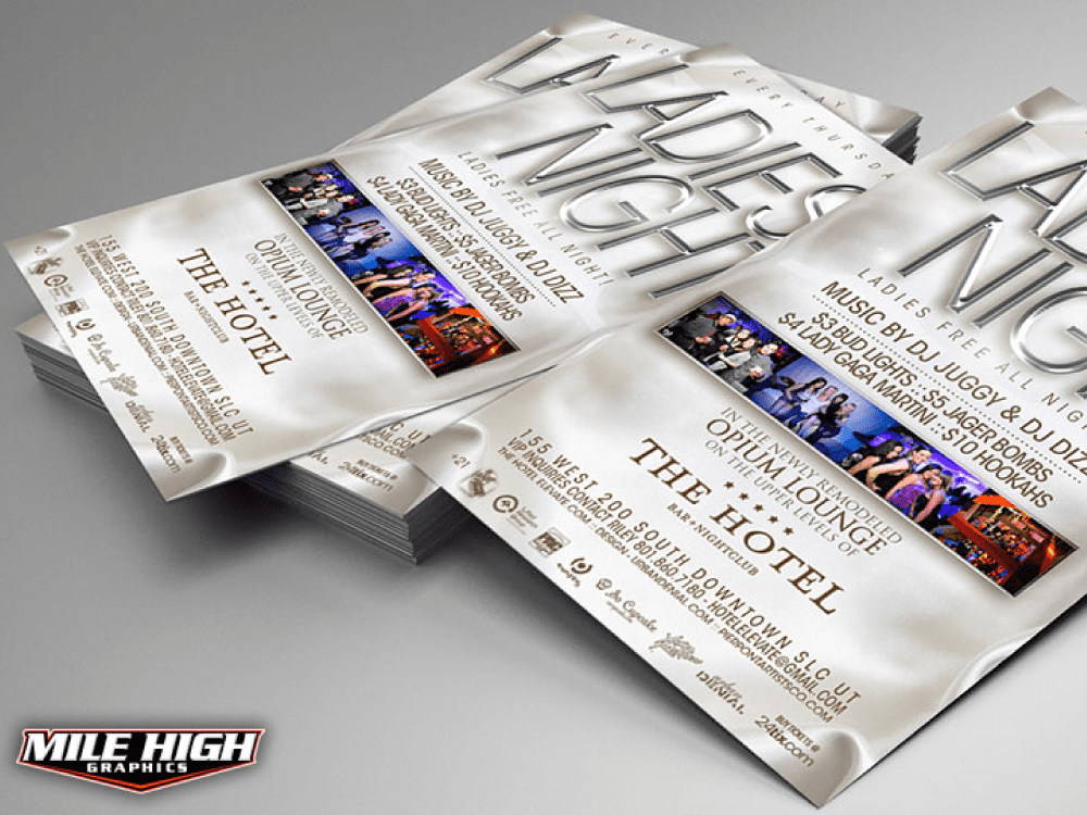 Stack of ladies night flyers with one falling off.
